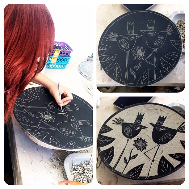 Rebecca Graves in the studio carving a platter.
